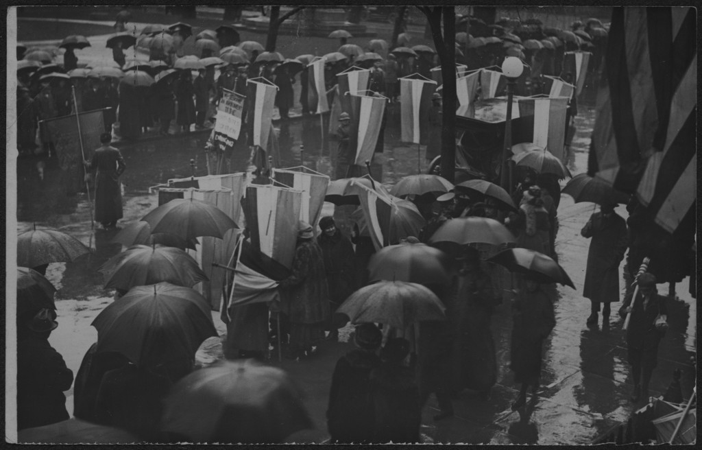 Suffragists picketing with banners in the rain during the Grand Picket, Mar. 4, 1917.